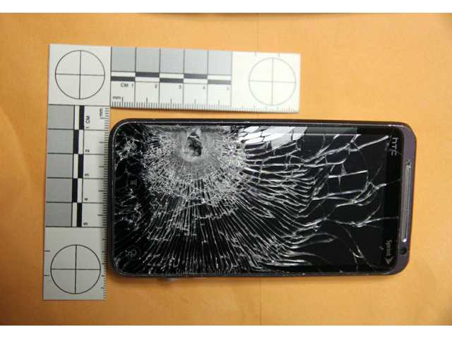 This Oct. 28, 2013 photo photo provided by the Winter Garden Police Department shows the front of the cellphone belonging to a Winter Garden, Fla.