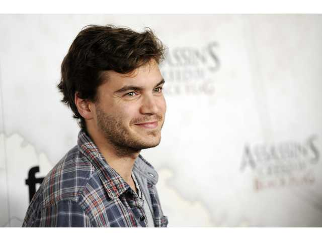 This Oct. 22, 2013 file photo shows actor Emile Hirsch poses at the Assassin's Creed IV Black Flag launch party at Greystone Manor in West Hollywood, Calif. Hirsch will play John Belushi in a biopic on the comedian.