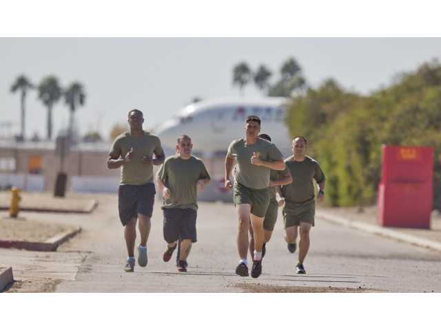 "In this, Oct. 17, 2013 photo, a group of sailors and Marines who failed the so-called ""tape test'' are led by an instructor on a three mile run as they work to improve their fitness and remain in the military, at the Marine Corps Recruit Depot in San Diego."