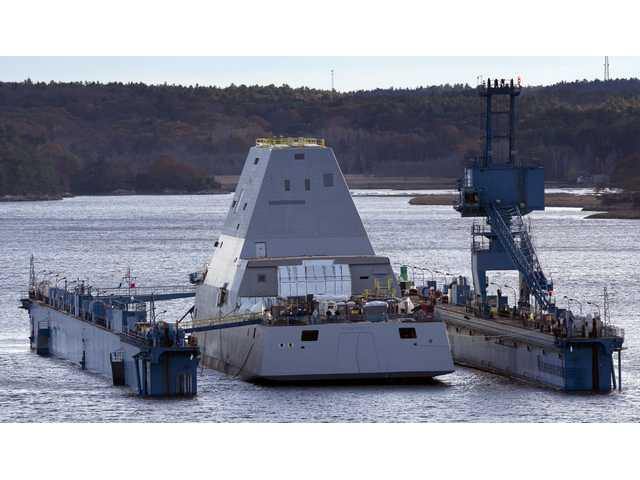 The first-in-class Zumwalt, the largest U.S. Navy destroyer ever built, floats off a submerged dry dock in the Kennebec River, Monday, Oct. 28, 2013, in Bath, Maine.