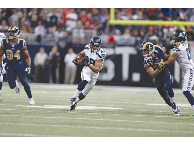 Seattle Seahawks wide receiver Doug Baldwin (89) runs against the St. Louis Rams on Monday in St. Louis.