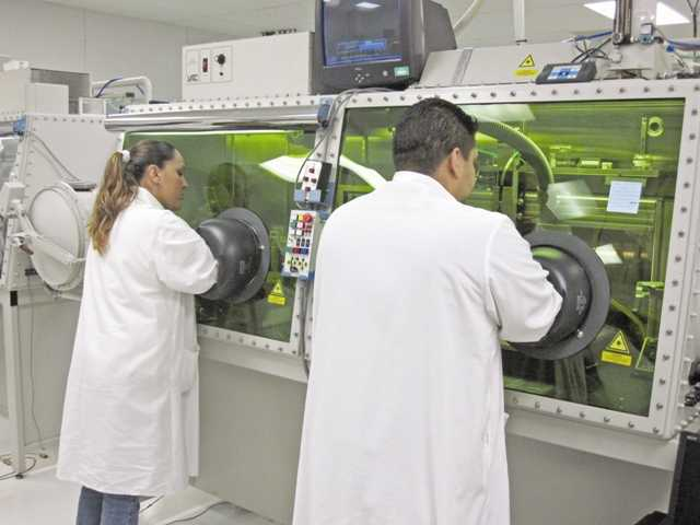 Quallion LLC lab employees work in the dry room in 2011to avoid contamination.