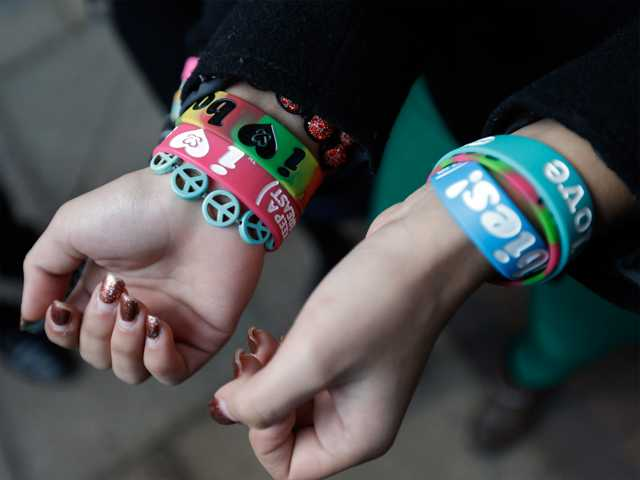 "In this Feb. 2013 file photo, Easton Area School District students Brianna Hawk, 15, left, and Kayla Martinez, 14, display their ""I (heart) Boobies!"" bracelets for photographers outside the U.S. Courthouse in Philadelphia."