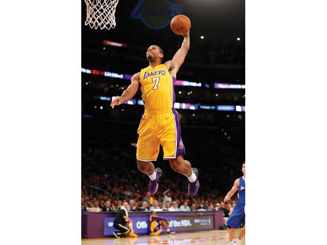 Los Angeles Laker Xavier Henry dunks the ball against the Los Angeles Clippers in Los Angeles on Tuesday.