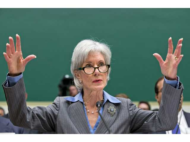 Health and Human Services Secretary Kathleen Sebelius gestures while testifying on Capitol Hill in Washington on Wednesday before the House Energy and Commerce Committee hearing on the difficulties plaguing the implementation of the Affordable Care Act.