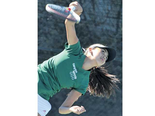 Katrina DeGuzman of Canyon tennis at The Paseo Club on Wednesday. DeGuzman advanced to today's semifinal round.