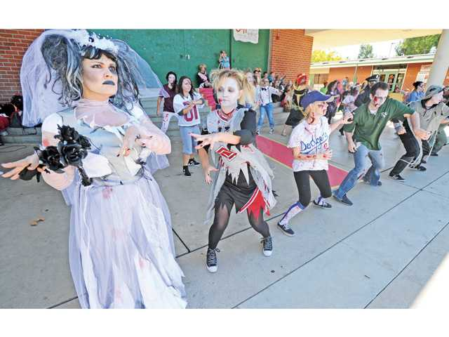 Teacher Jenni Frias, left, as a zombie bride joins Sierra Vista Junior High School faculty for a Halloween flash mob dance Thursday. Signal photo by Dan Watson