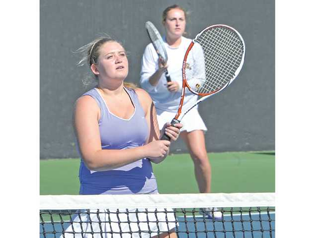 The Valencia doubles team of Remy Balmain, left, and Tina Inchalik won the Foothill doubles championship at The Paseo Club.
