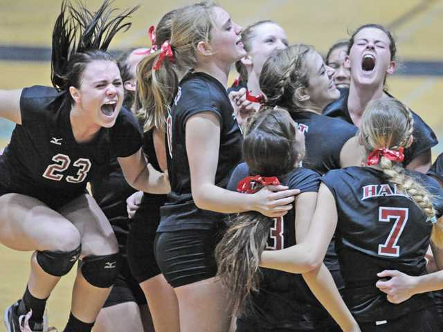 Hayden Harker (23), left, jumps for joy as she and her Hart High teammates celebrate after winning against Valencia at Hart on Thursday.
