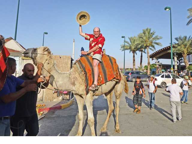 Darel Roberts smiles for the camera as he takes a camel ride during his trip to Israel. Darel strives to live life to the fullest every chance he gets. In spite of battling pancreatic cancer, he maintains a positive outlook on life.