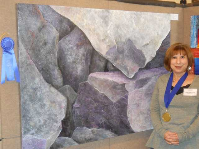 "Exhibiting artist, Laurie Finklestein, won first place in the acrylic category for her art titled ""A Boulder State of Being."""