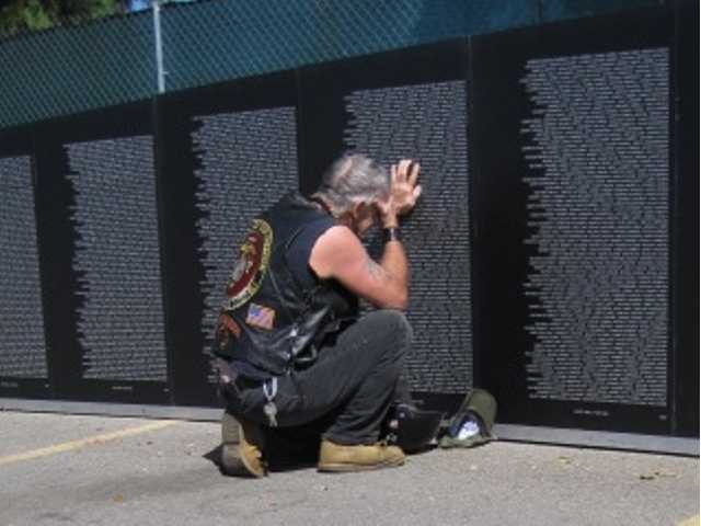 "The photo was titled ""An emotionally packed event,"" and was taken at the Traveling Vietnam Memorial Wall event held in Valencia over a four-day period September. Courtesy photo"