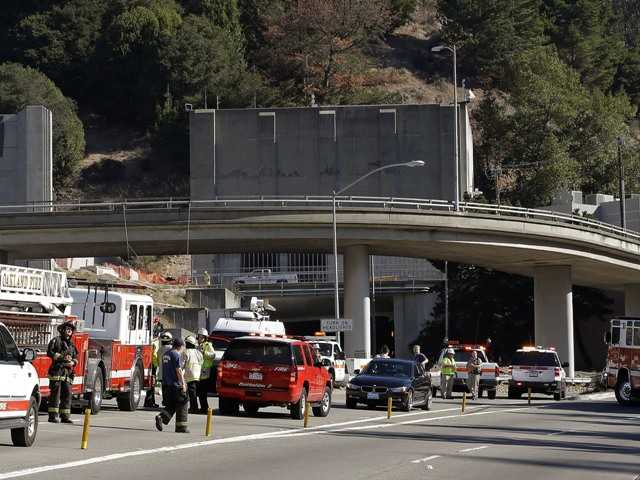 Emergency personnel wait at the blocked entrance to the Caldecott Tunnel in Oakland on Friday in response to a fire. The tunnel links Oakland to other east San Francisco Bay area communities.