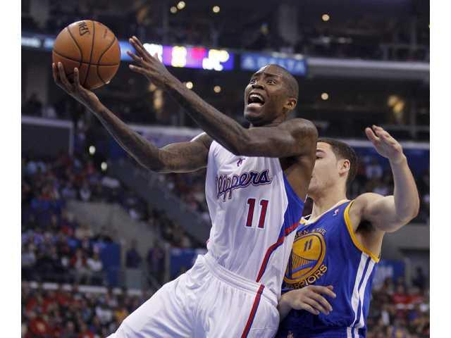 Los Angeles Clippers guard Jamal Crawford, left, drives to the basket with Golden State Warriors guard Klay Thompson, right, defending on Thursday in Los Angeles.