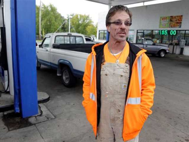Mike Barnett, of Fort Wayne, Ind., owner of an underground utility installation company, talks about purchasing on average about $250 a day in fuel as his employees fuel his van at a Marathon Station in Kokomo, Ind., Thursday, Oct. 24, 2013.