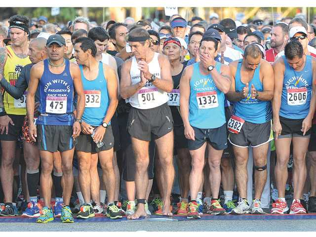 Participants of the full and half marathons gather at the starting line of the 2013 City of Santa Clarita Marathon as they join thousands of runners on McBean Parkway in Valencia on Sunday. Photo by Dan Watson.