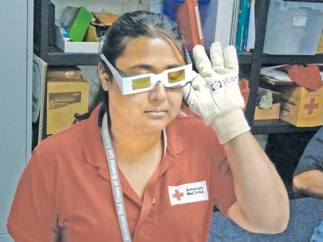 Rameena Rahman experiences some of the effects of aging during a SCAN Health Plan Trading Ages workshop for American Red Cross disaster relief volunteers. Courtesy photo.