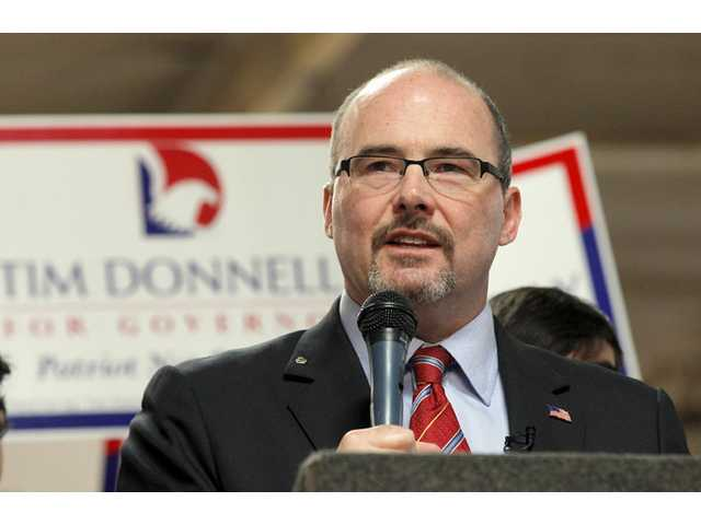 Assemblyman Tim Donnelly, R-Twin Peaks, announces he's running for California Governor in Baldwin Park on Tuesday.