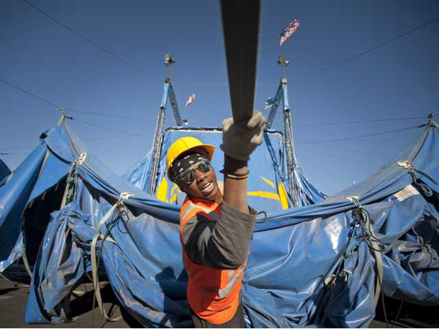 Electrician Marumbi Yoga pulls a rope connected to the big top tent for Circus Vargas at the Valencia Town Center parking lot on Tuesday. Photo by Charlie Kaijo.