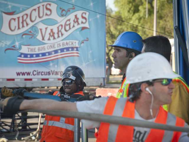 A crew works together to erect the big top tent for Circus Vargas at the Valencia Town Center on Tuesday. Photo by Charlie Kaijo.