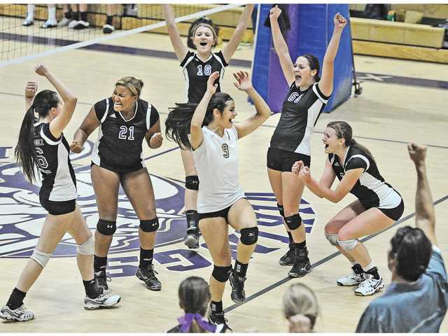 The Valencia High girls volleyball team celebrates after winning the match against West Ranch at Valencia High on Tuesday.