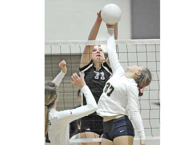 Valencia High's Lindsey Knudsen (71) goes up to block a shot by West Ranch's Lindsay Kunz (37) during Tuesday's match Valencia High.