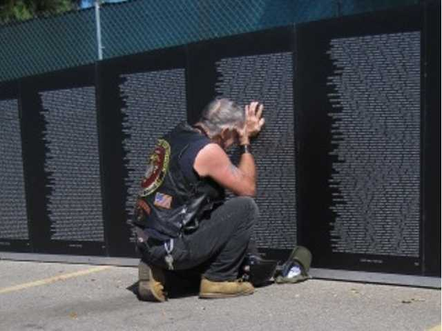 "The photo was title ""An emotionally packed event,"" and was taken at the Traveling Vietnam Memorial Wall event held in Valencia over a four-day period September. It published Nov. 3."