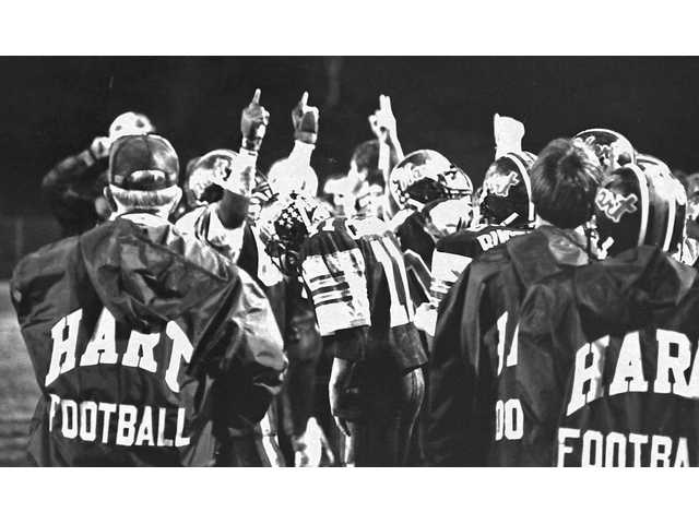 Hart High coaches and players celebrate on Dec. 9, 1983 at Cougar Stadium after defeating North Torrance for the CIF-Southern Section Coastal Conference championship.