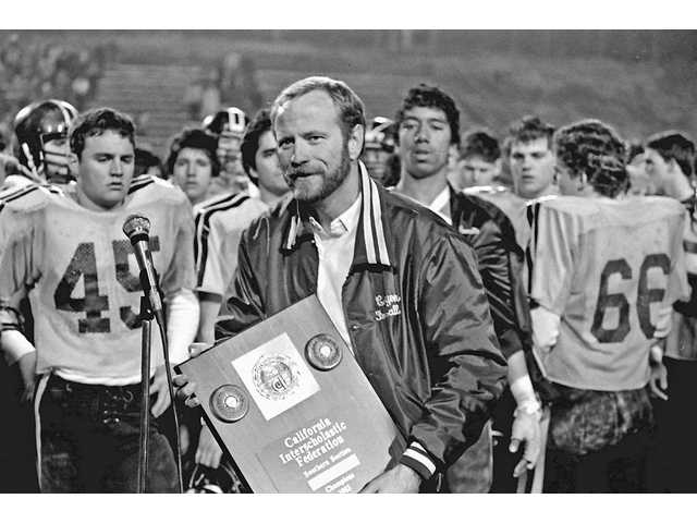 Canyon High head coach Harry Welch talks to the crowd after the Cowboys defeated Bishop Montgomery on Dec. 10, 1983 for the CIF-SS Northwestern Conference championship at Cougar Stadium.