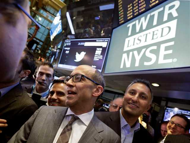 Twitter execs on the floor of the New York Stock Exchange Thursday for the company's public debut of its stock. The shares outperformed expectations and made a few new billionaries.