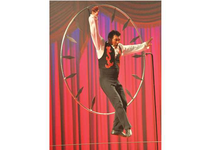 Zorro Low Wire jumps through a hoop of knives at Circus Vargas in Valencia on Thursday. Photo by Dan Watson.