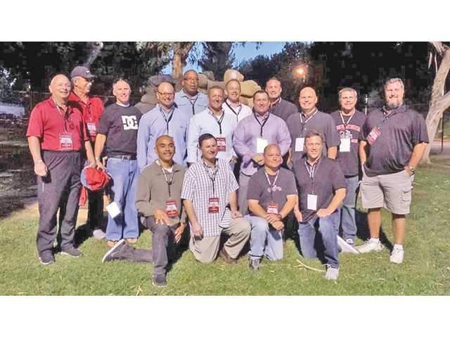 Members of the 1983 CIF champion Hart football team hold a reunion at TPC Valencia on Oct. 18.