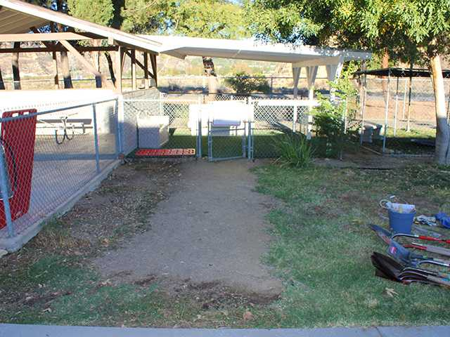 Before photo of the pathway to the doggie visiting area at the Castaic Animal Shelter. James Condello/courtesy photo