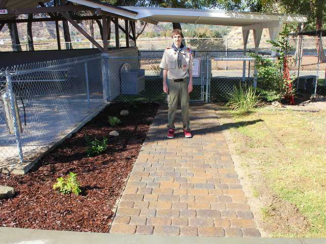 Anthony Condello stands on the newly built walkway leading to the canine visiting area at the Castaic Animal Center.