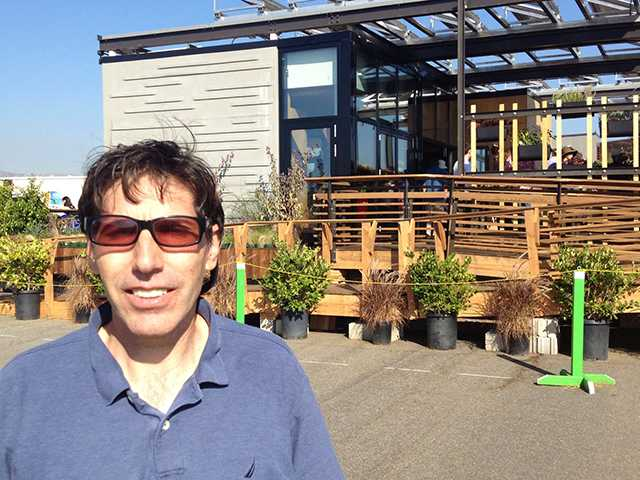 Keith Schmidt, Realtor, in front of The University of North Carolina-Charlotte entry called Urban Eden, one of winners at the 2013 Solar Decathlon, Oct. 2013.