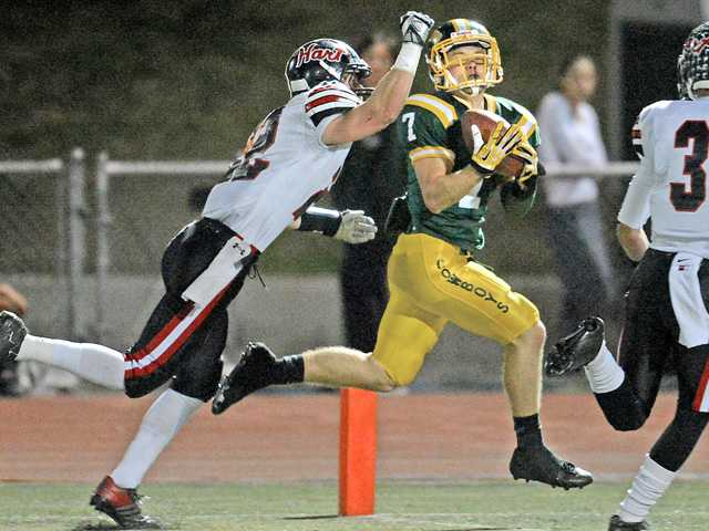 Canyon's Zach Cuha, right, pulls in a touchdown pass against Hart in the first quarter on Friday at Canyon High School. Canyon won the game 45-38.
