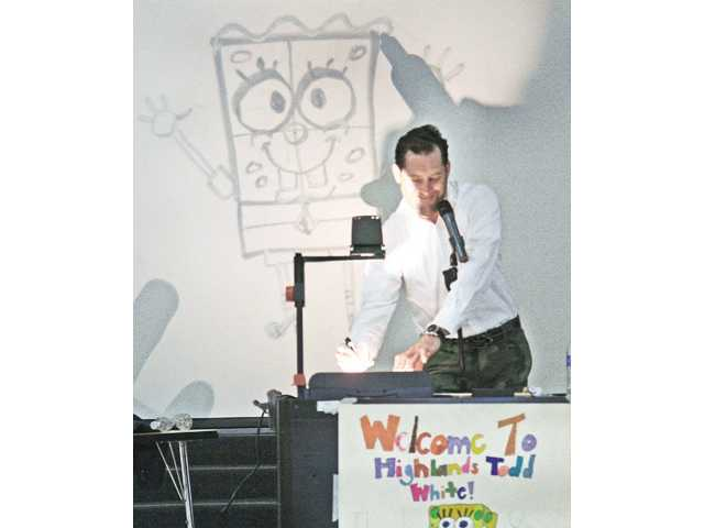 "Todd White teaches Highlands Elementary School students how to draw ""SpongeBob SquarePants"" during an art presentation Friday."
