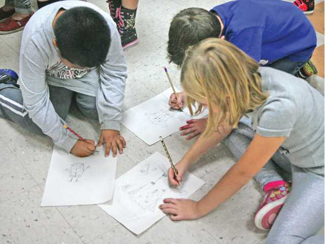 "Second grade students from Highlands Elementary School draw characters from the hit show, ""SpongeBob SquarePants,"" after Todd White's art presentation Friday."