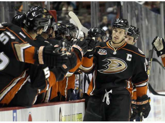 Anaheim Ducks center Ryan Getzlaf, right, is congratulated by teammates after his first of three goals in the first period against Buffalo Sabres.