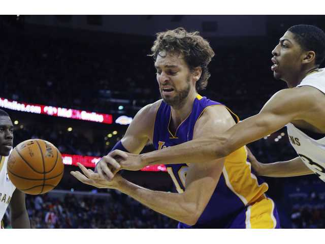 Los Angeles Lakers center Pau Gasol (16) has the ball knocked away by New Orleans Pelicans power forward Anthony Davis (23).