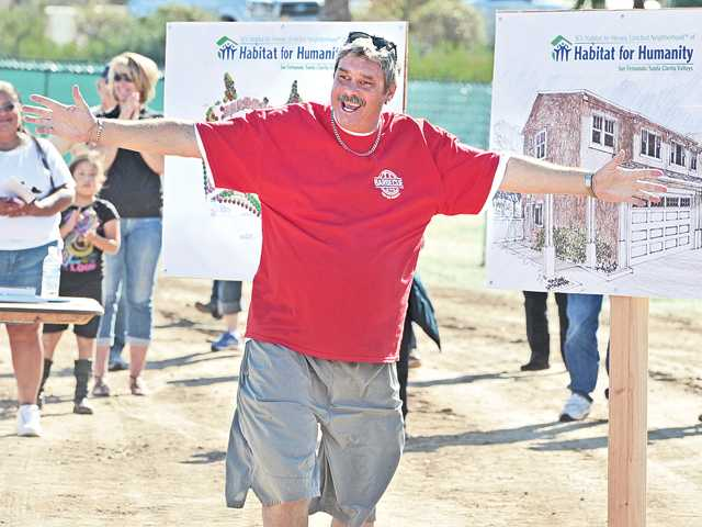 James Knoles celebrates as he is called forward as one of the Habitat Families who will receive one of the SCV Habitat for Heroes homes in Santa Clarita at the ground breaking ceremony during the Barbecue For the Troops event in Santa Clarita on Saturday. Signal photo by Dan Watson.