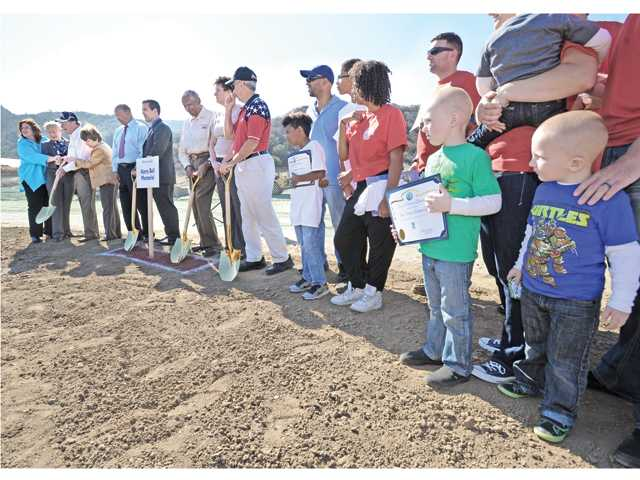 Ethan Towe, 5, second right, and his brother Aydan, 3, right, stand with their family who will receive one of the SCV Habitat for Heroes homes in Santa Clarita watch the ground breaking ceremony at the Barbecue For the Troops event in Santa Clarita on Saturday. Signal photo by Dan Watson.