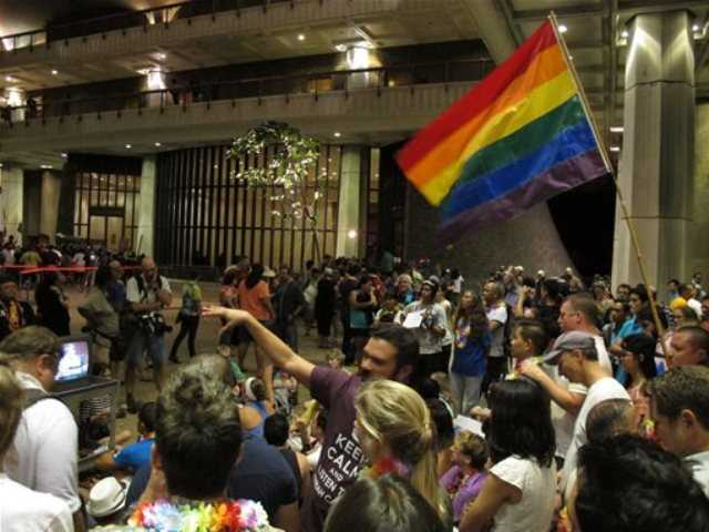 Proponents of gay marriage rally outside House chambers at the Hawaii Capitol in Honolulu on Friday, Nov. 8, 2013.