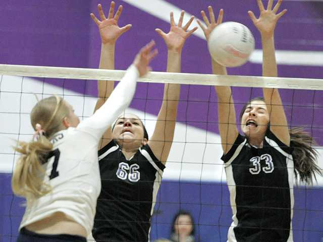 Valencia's Hayley Alvarez (66) and Holly Pittman (33) block a shot by West Ranch's Kendall Myers (7) at Valencia on Tuesday.