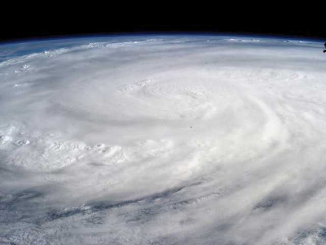 This image provided by NASA shows Typhoon Haiyan taken by Astronaut Karen L. Nyberg aboard the International Space Station Saturday Nov. 9, 2013. Rescuers in the central Philippines counted at least 100 dead and many more injured Saturday a day after one of the most powerful typhoons on record ripped through the region, wiping away buildings and leveling seaside homes in massive storm surges, then headed for Vietnam.