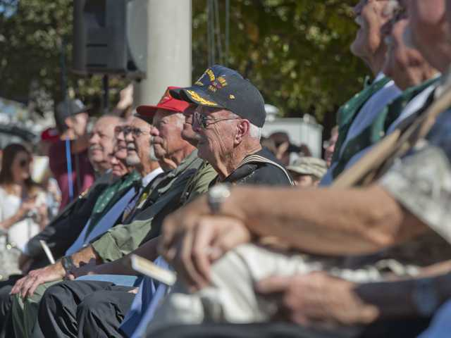 Military veterand sit together for a picture at the Veterans Day Ceremony held at the Veterans Historical Plaza on Monday. Signal photo by Charlie Kaijo
