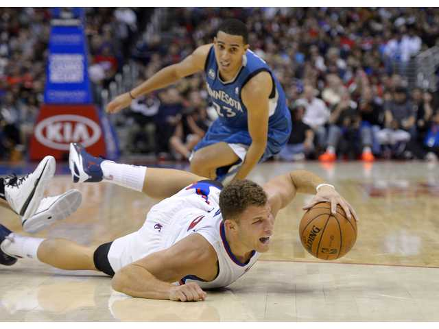 Clippers forward Blake Griffin beats Timberwolves guard Kevin Martin to a loose ball. Griffin finished with 25 points and 10 rebounds.