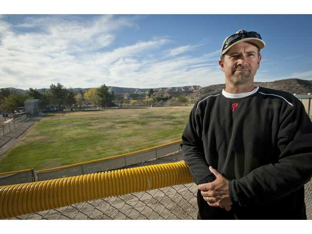Bill Picketts, newly appointed president of Canyon Country Little League, stands in front one of the league's baseball fields located near the corner of Sierra Highway and Vasquez Canyon Road.