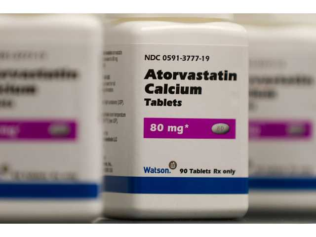 This undated photo provided by by Watson Pharmaceuticals Inc., shows Atorvastatin Calcium tablets, a generic form of Lipitor, which is being sold under a deal with Pfizer.