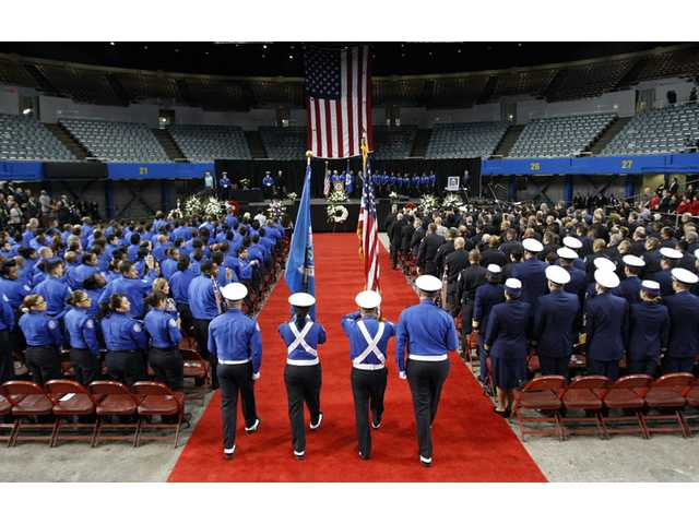 A Transportation Security Administration officer color guard enters the Los Angeles Sports Arena for a public memorial service for slain TSA officer Gerardo Hernandez on Tuesday.